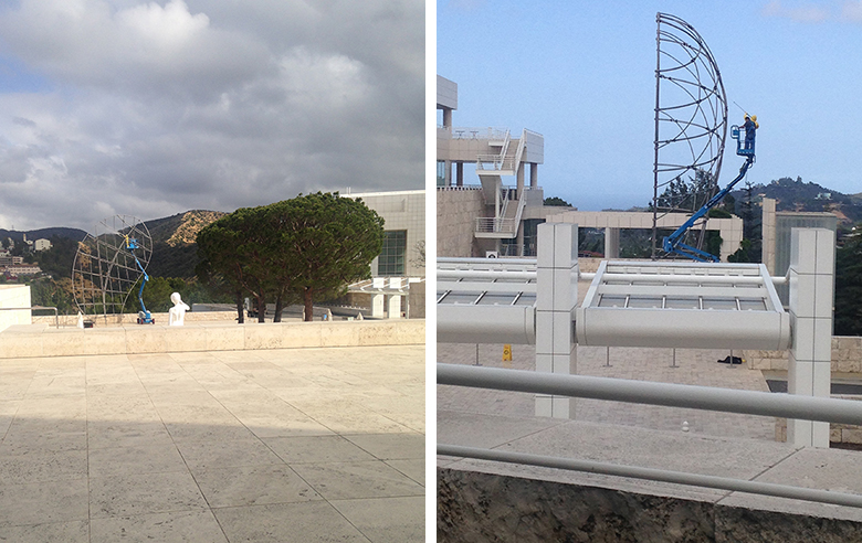 Two photographs showing a sculpture being cleaned in the grounds of the Getty Museum in Los Angeles.