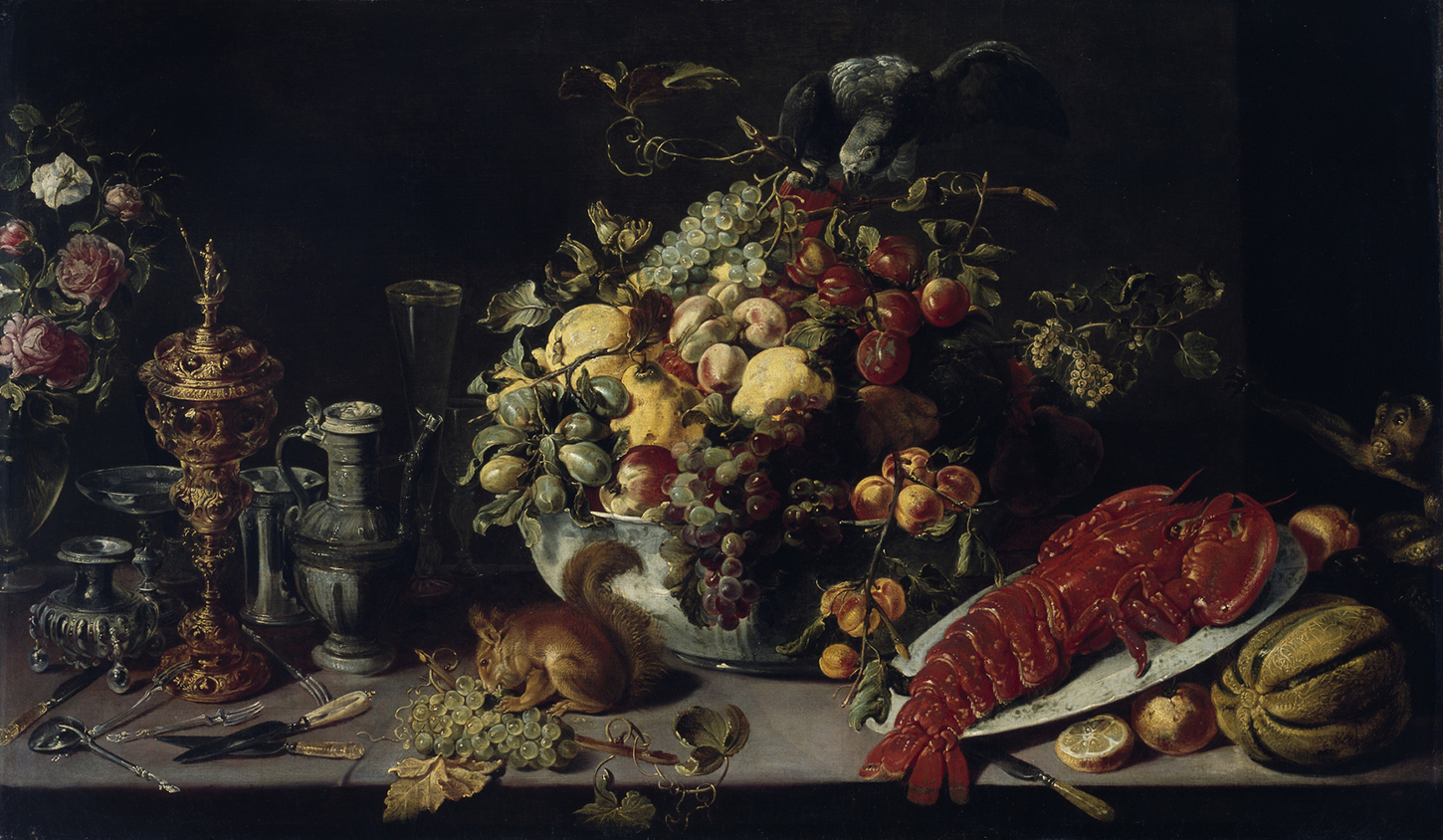 A view of a banquet table. Among the food shown (lobster, fruit, vegetables) we see a squirrel on the table, and to the right, a small monkey.