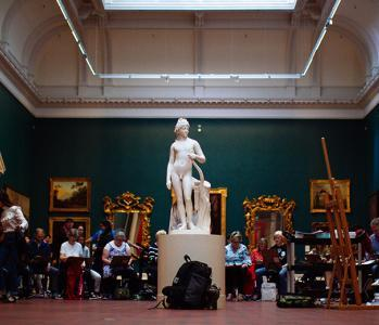 Visitors taking part in a drawing workshop in the Grand Gallery of the National Gallery of Ireland.