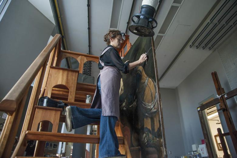 Getty Paintings conservator Devi Ormond cleans Guercino's 'Jacob Blessing the Sons of Joseph', c. 1620. Photo © Getty Museum