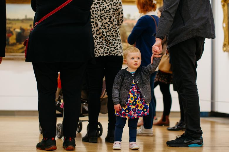 A young child on a free family friendly tour in the Millennium Wing. © National Gallery of Ireland