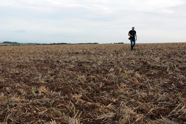 Artist Garrett Phelan recording sound in the field where the Battle of the Somme took place.