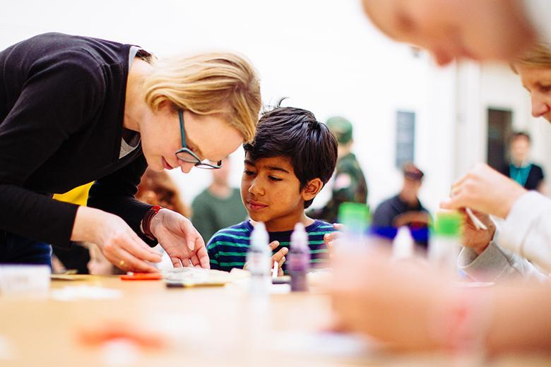 Photo of a young boy making art with a woman during a creative workshop at the National Gallery of Ireland.