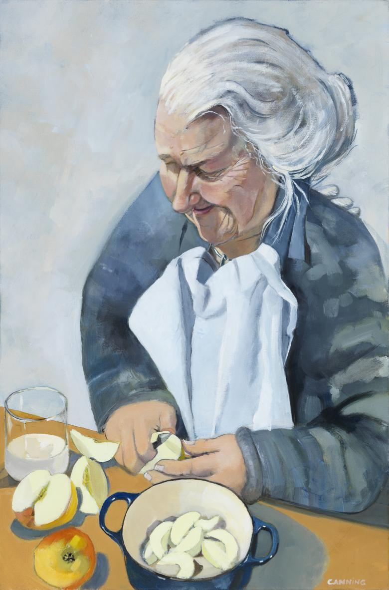 A woman stands over a counter, slicing and peeling apples and placing them in a pot in front of her. She has upswept grey hair, and is frowning in concentration.