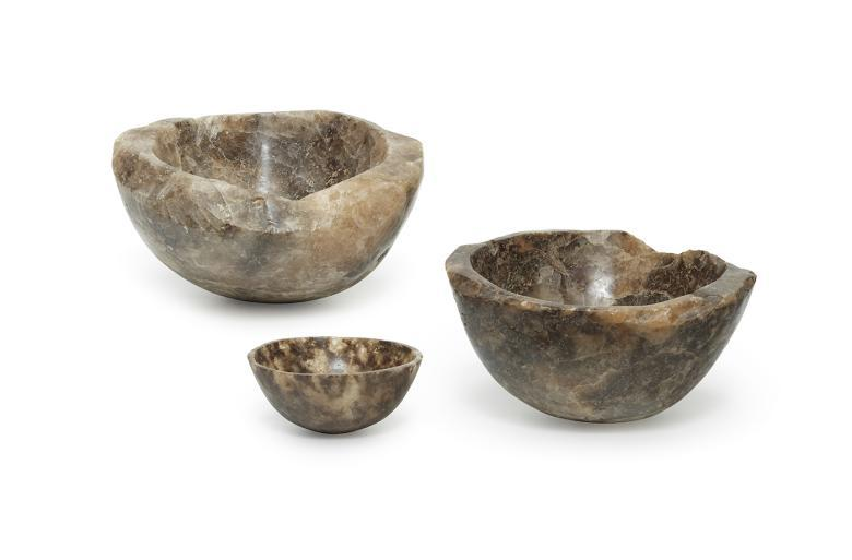 Three brown-hued bowls carved out of rock salt