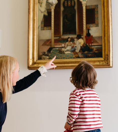A child on a free tour of the permanent collection in the Millennium Wing in front of 'Women in an Eastern Courtyard'. © National Gallery of Ireland