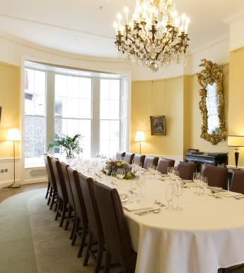 Photo of a board room set up for a dinner event in a Georgian building