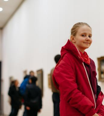A girl in the exhibition rooms in the Millennium Wing.