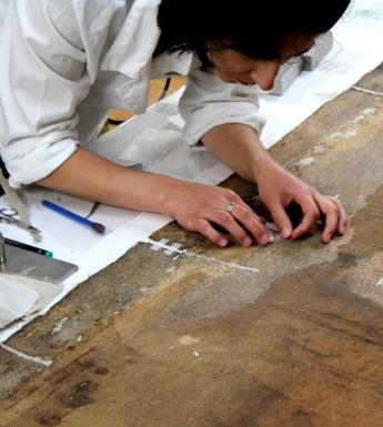Working on a canvas in the conservation department. © National Gallery of Ireland