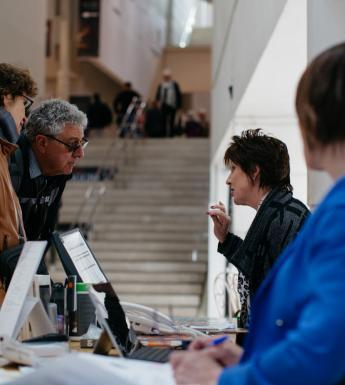 Visitors at the Information Desk. © National Gallery of Ireland.