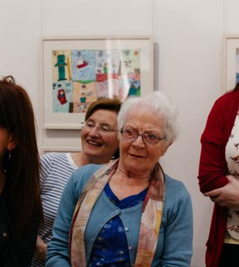 A tour group in the exhibition 'Imagining Ireland'. © National Gallery of Ireland.