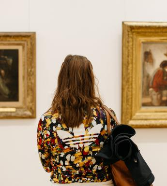 A visitor inside the exhibition rooms of the Millennium Wing. © National Gallery of Ireland.