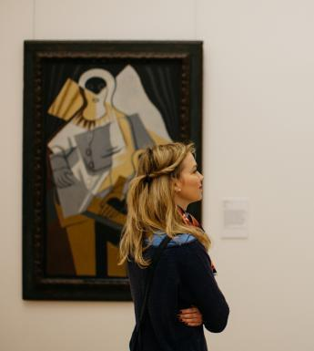 Woman looking at a painting