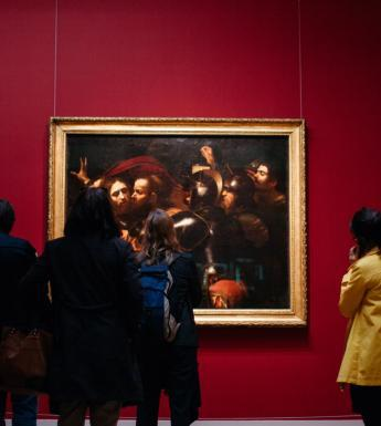Visitors to Beyond Caravaggio in front of the Taking of Christ. © National Gallery of Ireland.