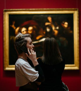 A visitor listening to an audio guide of Beyond Caravaggio. © National Gallery of Ireland.