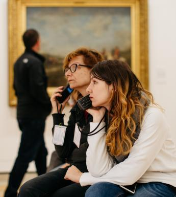 Visitors to the gallery listening to audioguides. © National Gallery of Ireland.