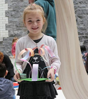 A young girl showing off the artwork that she created at a drop-in family workshop in the National Gallery of Ireland.