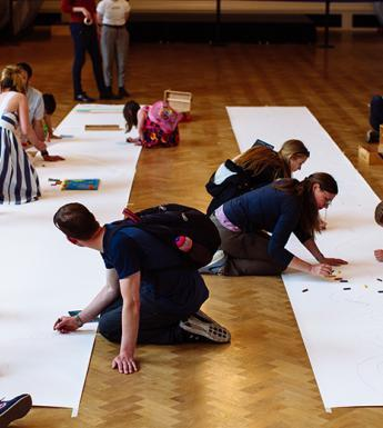 People taking part in a drawing activity in the National Gallery of Ireland.