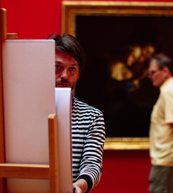 A visitor working at an easel in the Gallery.