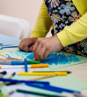 A child drawing during a drop-in family workshop at the Gallery.