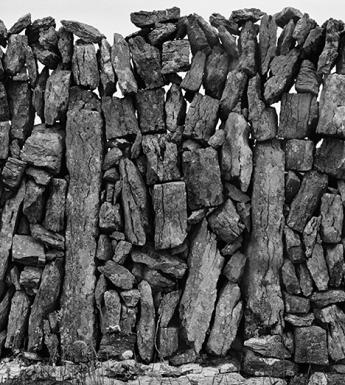 Black and white close-up photograph of a dry-stone wall.
