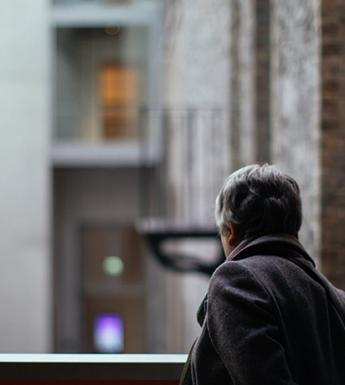 Photo of a woman looking over a balcony in the courtyard of the National Gallery of Ireland.