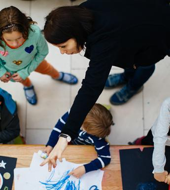 Aerial photo of four children and a woman taking part in a family creative workshop in the National Gallery of Ireland