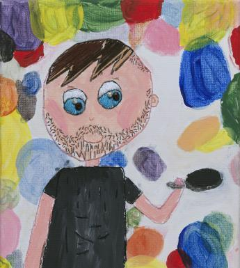 A blue eyed man in a black t-shirt holds a frying pan aloft, as if flipping pancakes. He is surrounded by discs of different colours, so that we can't tell which are the pancakes.
