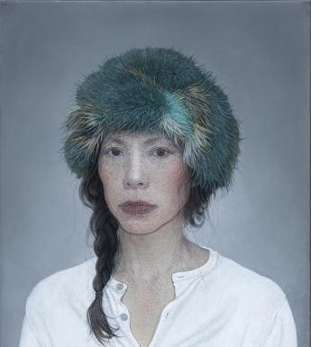 The subject of the portrait wears a white collarless shirt, and has a green fur hat on her head. Her dark hair is in a plait which is over one shoulder, with loose tendrils. She looks directly at the viewer.