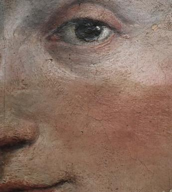 Close-up detail of where the yellowed varnish has been removed from the top half of the face on the Fontana canvas.
