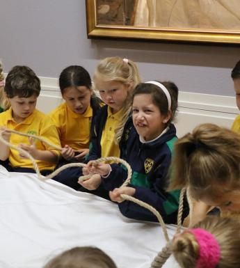 Group of school children taking part in an interactive tour of the Sorolla exhibition