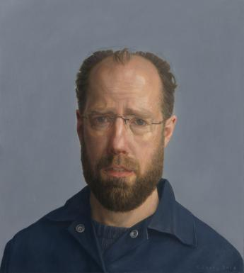 The sitter looks directly at the viewer. We see his head and shoulders. He wears an open neck dark blue shirt over a dark blue t-shirt. The background is a slightly lighter shade of blue-grey.