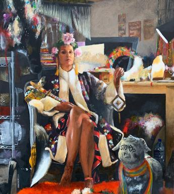 Portrait of woman seated in her studio surrounded by objects and materials