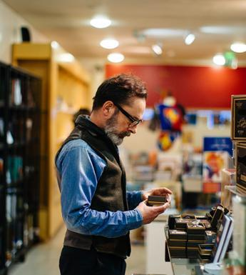 Photo of a man standing in the National Gallery of Ireland shop.
