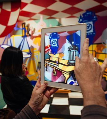 Hands holding up a tablet to take a photograph of Maser's installation for the After Vermeer display at the National Gallery of Ireland in September 2017.