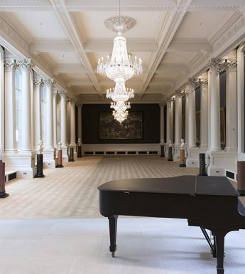 View of the Shaw Room at the National Gallery of Ireland, with a piano in the foreground.