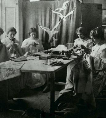 Vintage black and white photo of women sewing