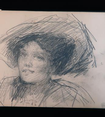 A sketchbook lies pen on a page with a pencil drawing of a woman in a hat