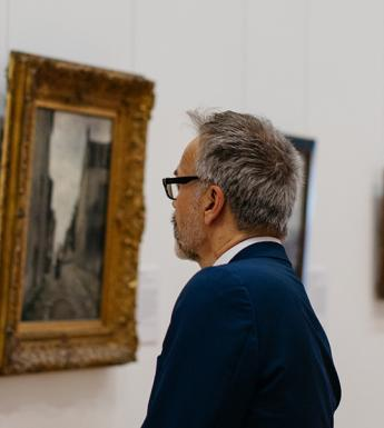 Man looking at a painting in the Millennium Wing of the National Gallery of Ireland.