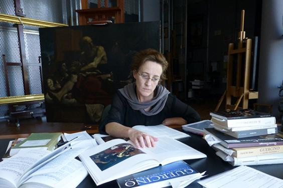 In preparation for conserving Jacob Blessing the Sons of Joseph, the Getty's associate conservator Devi Ormond researches the history of the painting. Photo © Getty