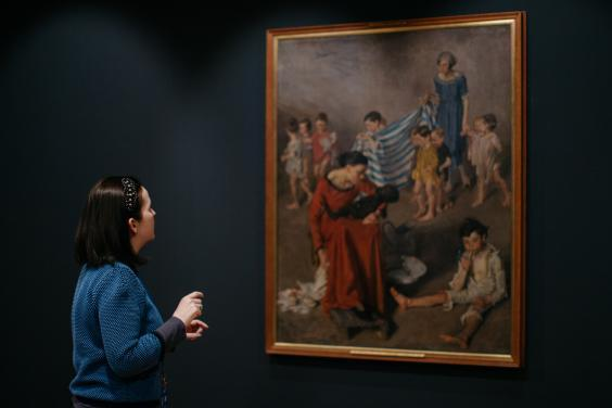 Niamh MacNally in front of a Margaret Clarke painting. © National Gallery of Ireland.