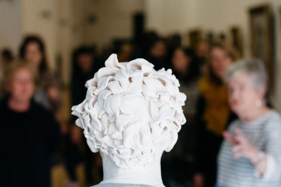 A tour group from behind the bust of Gerry Hynes by Vera Klute. © National Gallery of Ireland.