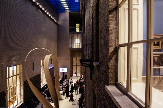 Photo of people at an evening event in the Courtyard of the National Gallery of Ireland.
