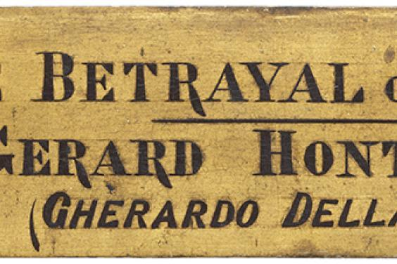 Photo of a nameplate attached to the frame of Caravaggio's painting