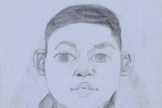 A pencil drawing of a young boy. The boy is facing the viewer directly, and has large eyes, expressive eyebrows, and has his hair cut short. He is wearing a hoodie zipped up to his neck, and we can see the words GAP across his chest.
