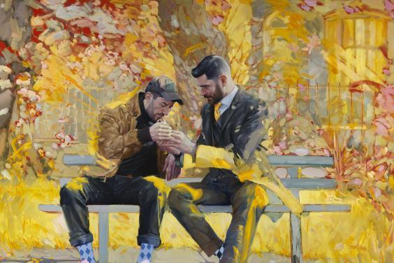 Two figures sit on a park bench. One, dressed in a suit, is lighting the cigarette of the other, dressed in a leather jacket and a baseball cap. Behind them, a riot of yellow, orange and pink, which is picked up in paint strokes on them.