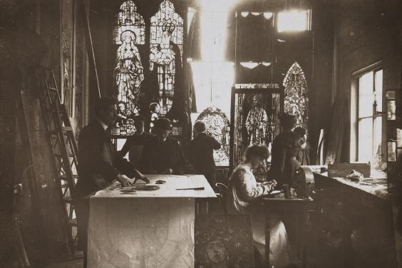 Vintage black and white photo of a stained glass studio
