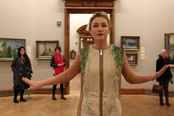 Performance artist Amanda Coogan walking through the National Gallery of Ireland as part of her performance Floats in the Aether.