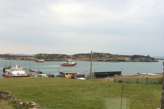 Photo of boats coming into harbour on Inishbofin