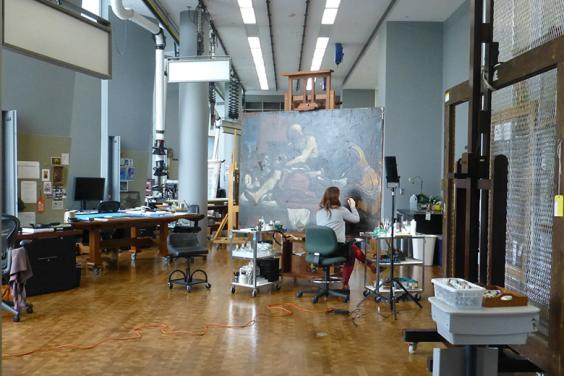A view of the conservation studio in the Getty Museum with maria Canavan working on Guercino's painting called Jacob Blessing the Sons of Joseph.